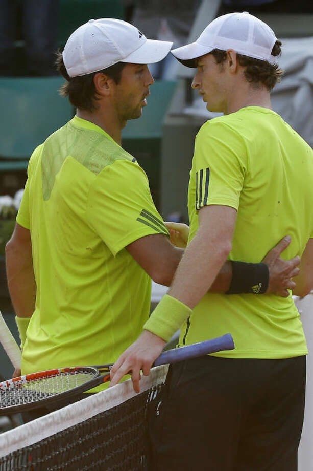 Britain's Andy Murray and Spain's Fernando Verdasco hug after their fourth round match of the French Open tennis tournament against at the Roland Garros stadium, in Paris, France, Monday, June 2, 2014. Murray won in three sets 6-4, 7-5, 7-6. (AP Photo/Michel Euler)