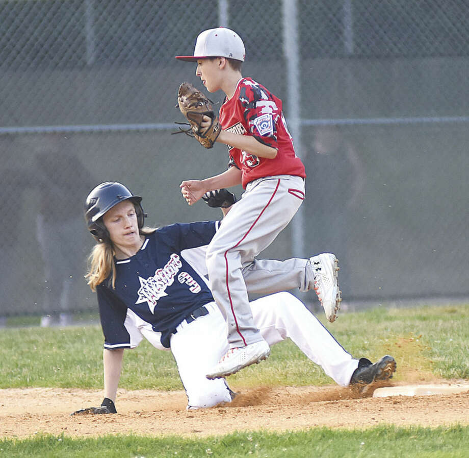 Hour photo/John NashWestport's Tobey Patton, left, is forced out at second base by North End's shortstop during Monday's opening round game of the District 2 All-Star Little League tournament in Trumbull.