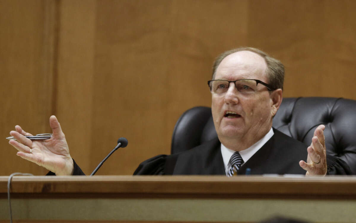 Judge Larry Hendricks asks a question of defense counsel during a hearing in Shawnee County District Court, Thursday, June 25, 2015, in Topeka, Kan. Hendricks blocked the state's first-in-the-nation ban on an abortion procedure that opponents refer to as