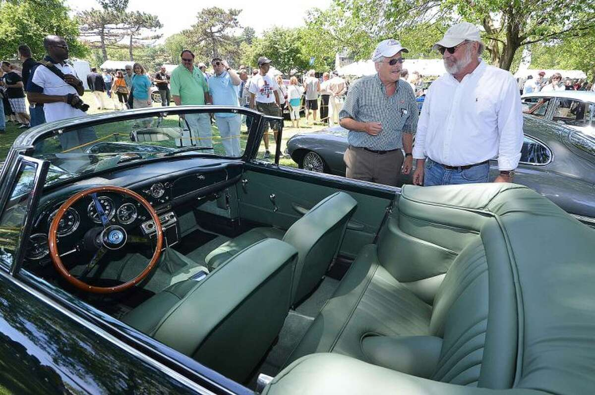 Hour Photo/Alex von Kleydorff Tom Fuller talks with another Aston Martin owner about his perfect 1962 Aston Martin DB 4 Convertible fresh from a ground up restoration during Greenwich Concours d'Elegance, The Concours International. Imported Classic, Sports, Touring and Competition Automobiles 1900-1990's
