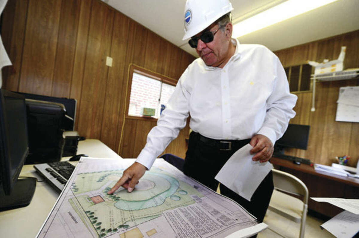 Hour photo / Erik Trautmann Dominic DiGangi, general manager of First Taxing District goes over the plans for The District's $7 million project to replace the water tower and pumping station at 34 Grandview Ave. The project will also include repainting of the old three-million water tank.