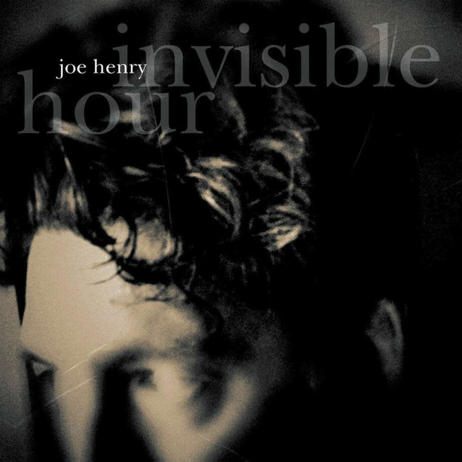 "This CD cover image released by Work Song shows ""Invisible Hour,"" by Joe Henry. (AP Photo/Work Song)"