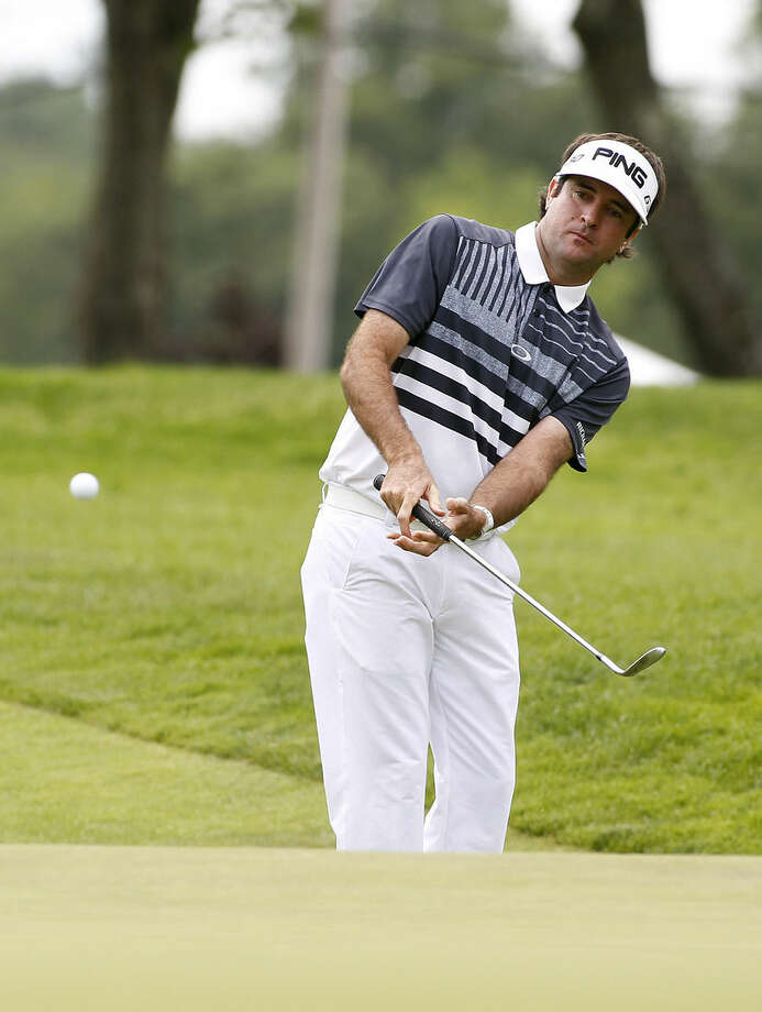 Bubba Watson chips to the ninth green during the first round of the Travelers Championship golf tournament, Thursday, June 25, 2015, in Cromwell, Conn. Watson made a birdie on the hole. (AP Photo/Stew Milne)