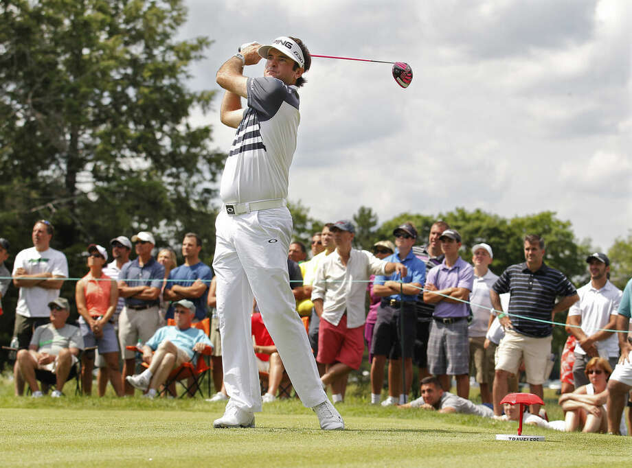 The gallery watches as Bubba Watson tees off on the sixth hole during the first round of the Travelers Championship golf tournament, Thursday, June 25, 2015, in Cromwell, Conn. (AP Photo/Stew Milne)