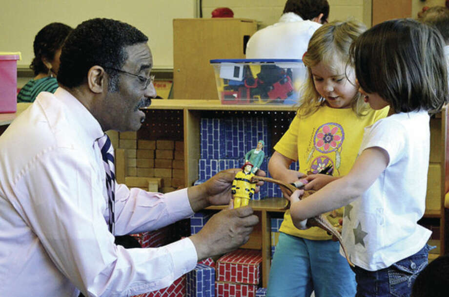 Hour photo / Liana Sonenclar State Representative Bruce Morris (D-Norwalk) plays with Kate Finn and Caleigh OIsen at Fox Run Elementary School Tuesday after a press conference aimed to increase access to pre-Kindergarten in Norwalk and across Connecticut.