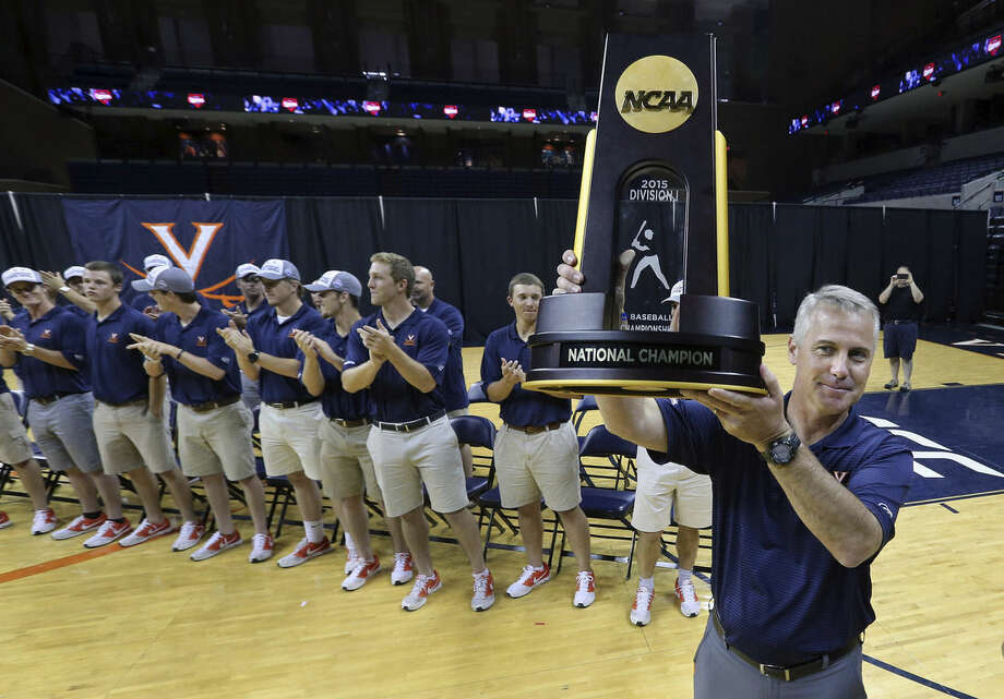 Virginia baseball coach Brian O'Connor holds up the NCAA baseball championship trophy at a celebration rally Thursday, June 25, 2015, in Charlottesville, Va. (P. Kevin Morley/Richmond Times-Dispatch via AP)