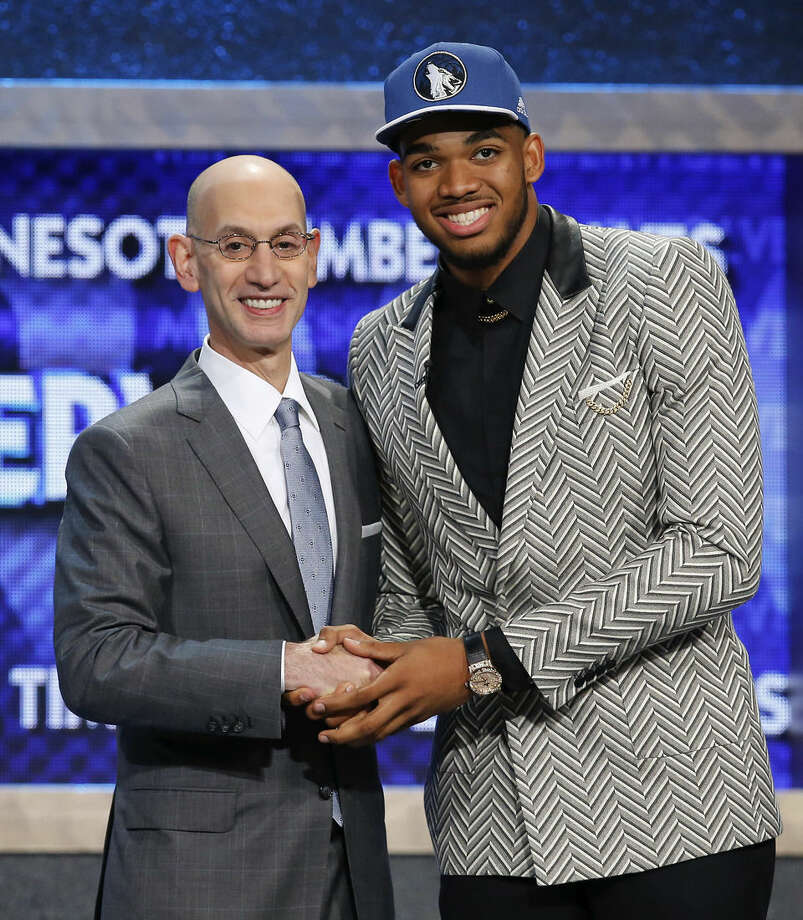 Karl-Anthony Towns, right, poses for a photo with NBA Commissioner Adam Silver after being announced as the top pick during the NBA basketball draft by the Minnesota Timberwolves, Thursday, June 25, 2015, in New York. (AP Photo/Kathy Willens)