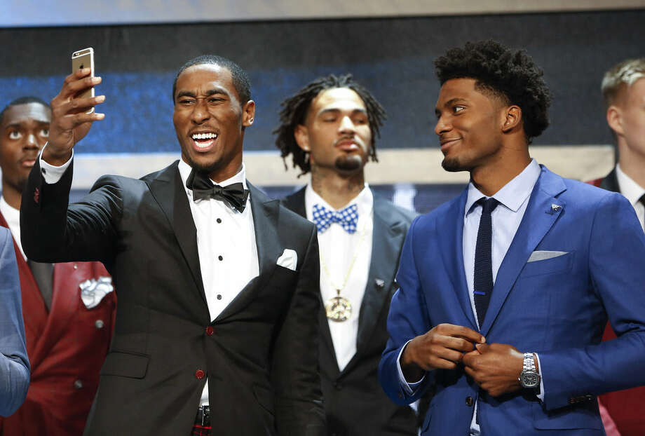 Rondae Hollis-Jefferson, left, takes a selfie next to with Justise Winslow before the NBA basketball draft, Thursday, June 25, 2015, in New York. (AP Photo/Kathy Willens)