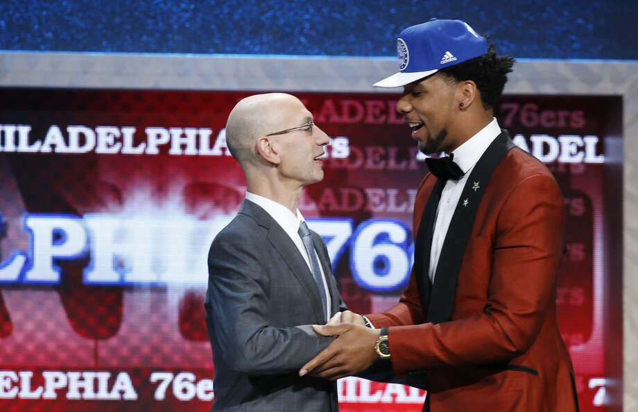 Jahlil Okafor, right, is greeted by NBA Commissioner Adam Silver after being selected third overall by the Philadelphia 76ers during the NBA basketball draft, Thursday, June 25, 2015, in New York. (AP Photo/Kathy Willens)