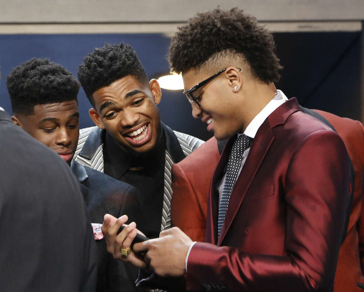 From left, NBA draft prospects Emmanuel Mudiay, Karl-Anthony Towns and Kelly Oubre Jr. talk during a photo op before the NBA basketball draft, Thursday, June 25, 2015, in New York. (AP Photo/Kathy Willens)