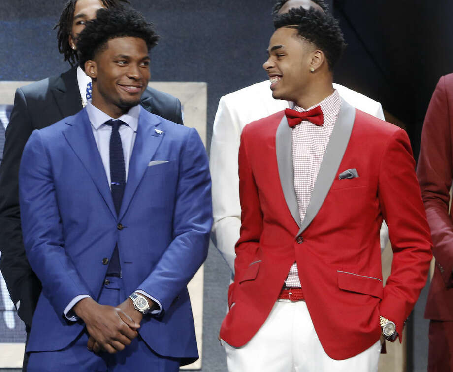 Justise Winslow, left, and D'Angelo Russell talk during photo session before the NBA basketball draft, Thursday, June 25, 2015, in New York. (AP Photo/Kathy Willens)