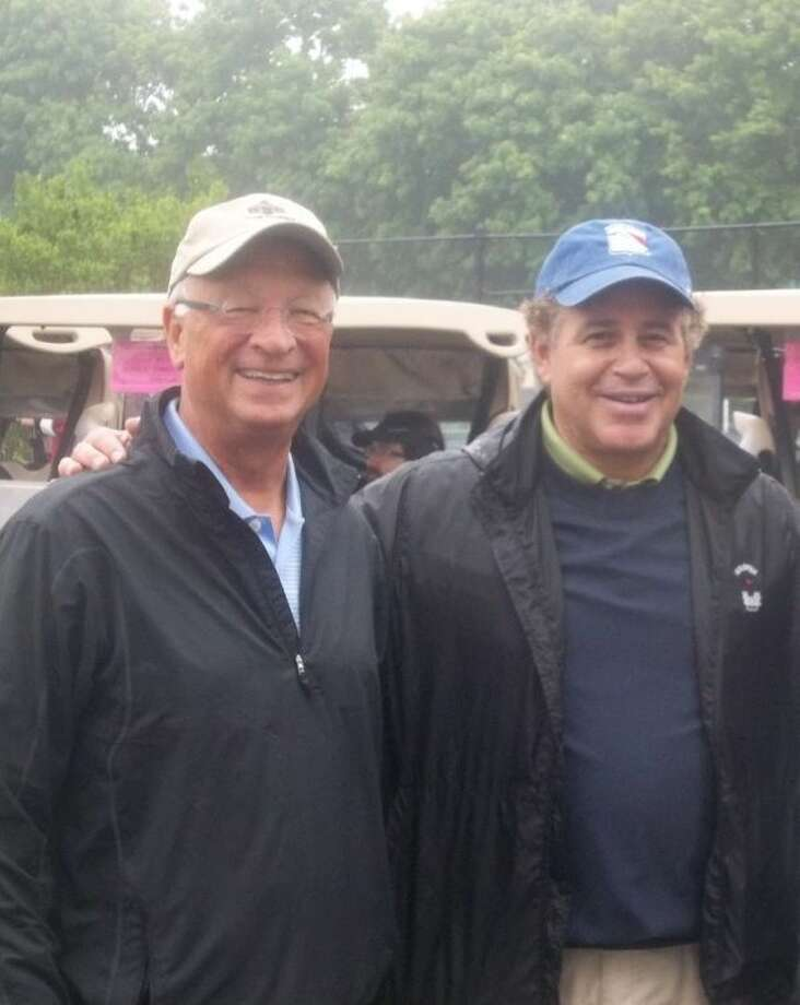 Barry Coutant and Mike Mezzapelle, board members ready to play rainy day golf at the Senior Services of Stamford's Annual Charity Golf Outing