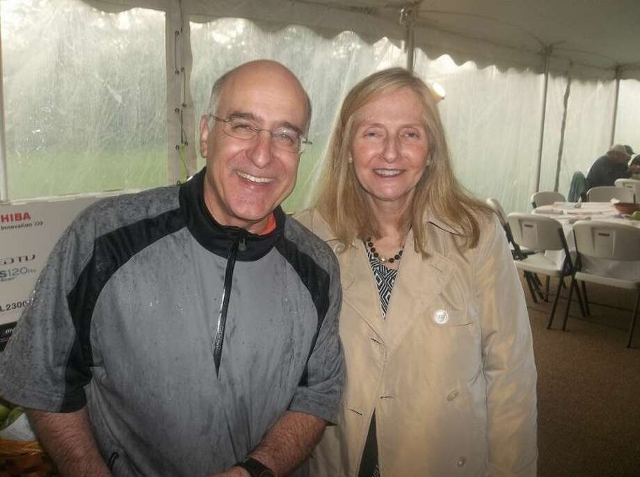 Bill Hennessey and Diana Lenkowsky, in from the rain at the Senior Services of Stamford's Annual Charity Golf Outing.