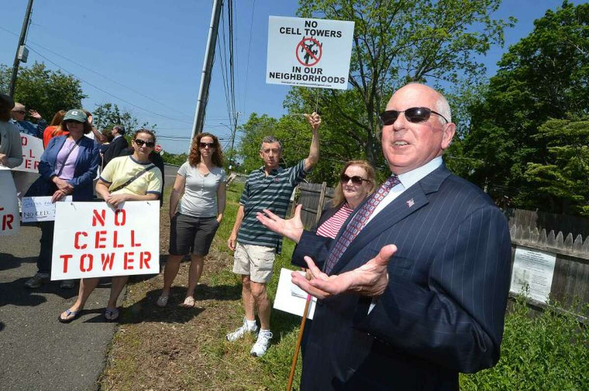 Hour Photo/Alex von Kleydorff Westport First Selecman James Marpe speaks to residents as they protest the constuction of a 120ft. high cell tower off Greens Farms rd