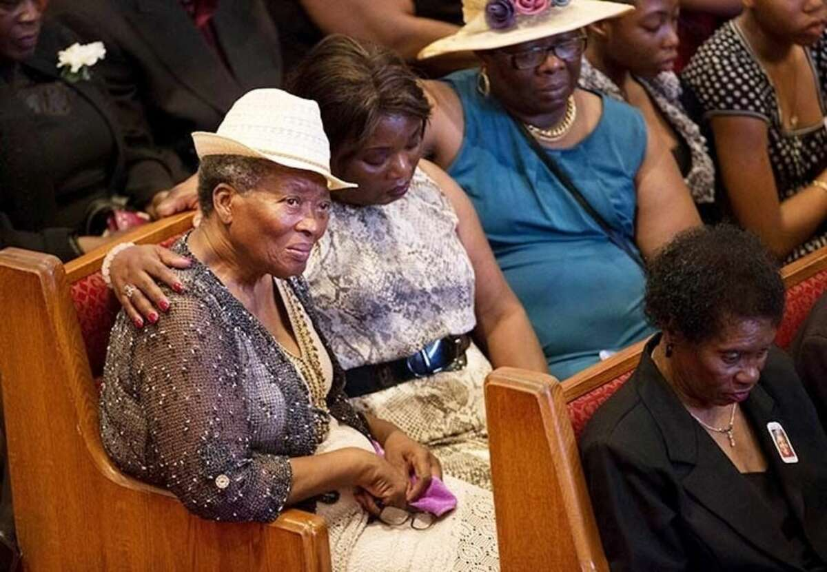 AP photo/David Goldman Mourners gather before the funeral service for Ethel Lance, one of the nine people killed in the shooting at Emanuel AME Church last week in Charleston, Thursday in North Charleston, S.C.