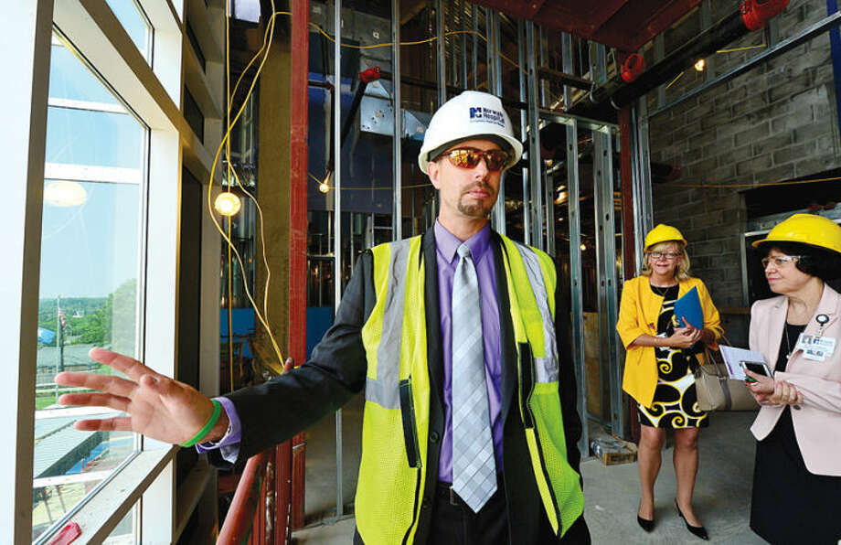 Hour photo / Erik Trautmann JIm Haynes, VP of Operations, gives a tour of Norwalk Hospital's construction of the five-story, 95,500-square-foot Anne P. and Harold W. McGraw, Jr. Center, an outpatient pavilion to serve, emergency patients and outpatient surgeries.