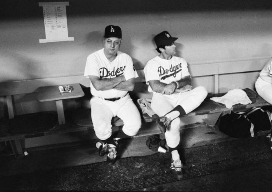 FILE - In this Oct. 17, 1978 file photo, Los Angeles Dodgers Manager Tom Lasorda, left, and first baseman Steve Garvey look dejected in the dugout during a loss to the New York Yankees in Game 6 of the World Series. It's been 33 years since teams from these cities played for a title. The rivalry could be lost on many fans when the Kings and Rangers meet for the Stanley Cup. (AP Photo/File)