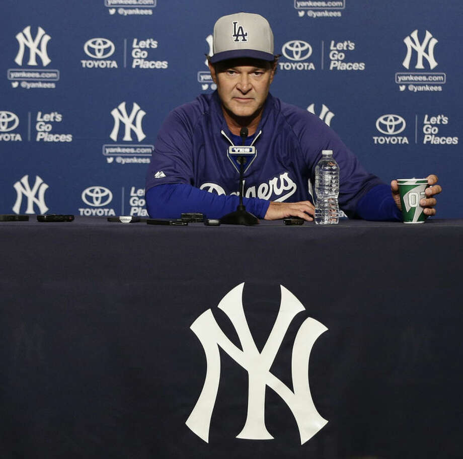 FILE - In this June 18, 2013 file photo, Los Angeles Dodgers manager Don Mattingly, a former New York Yankees player, responds to questions during a news conference before a baseball game against the New York Yankees, in New York. It's been 33 years since teams from these cities played for a title. The rivalry could be lost on many fans when the Kings and Rangers meet for the Stanley Cup. (AP Photo/Frank Franklin II, File)
