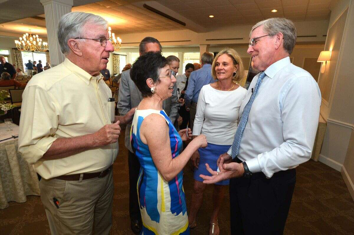 Hour Photo/Alex von Kleydorff. Manresa Association President Charlie Taney, right, talks with the Executive Board John Moeline Phil Crosland, Louise Flax and Connie Bennett at the Association's meeting at Shore and Country Club