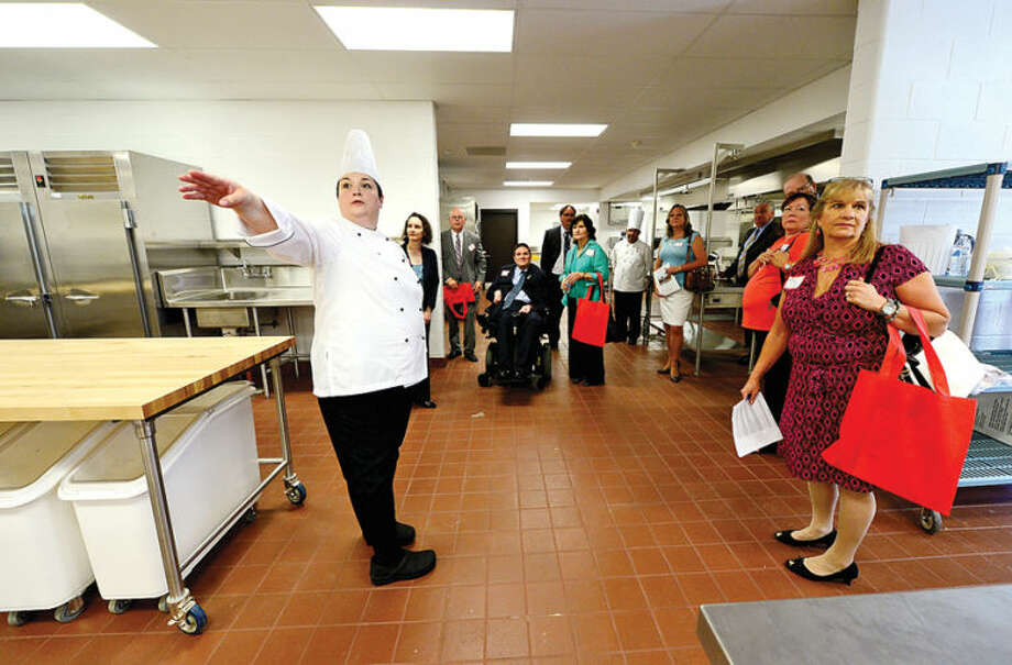 Hour photo / Erik Trautmann Head of the Culinary Arts Department at the New Wright Techical High School, Francine Bove, left, gives a tour of the culinary arts kitchen during a media briefing on the reopening of Wright Tech this Fall.