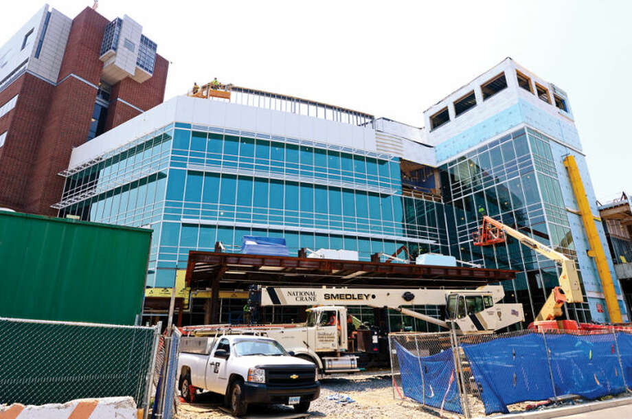 Hour photo / Erik Trautmann Norwalk Hospital's construction of the five-story, 95,500-square-foot Anne P. and Harold W. McGraw, Jr. Center, an outpatient pavilion to serve, emergency patients and outpatient surgeries.