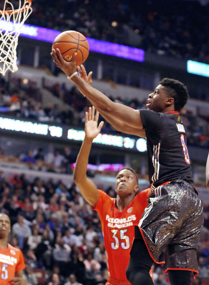 FILE - In this April 2, 2014, file photo, McDonald's West All-American Emmanuel Mudiay (0) shoots a lay-up during the first half of the McDonald's All-American boy's basketball game in Chicago. Mudiay is a top prospect in the NBA draft on Thursday, June 25, 2015. (AP Photo/Charles Rex Arbogast, File)