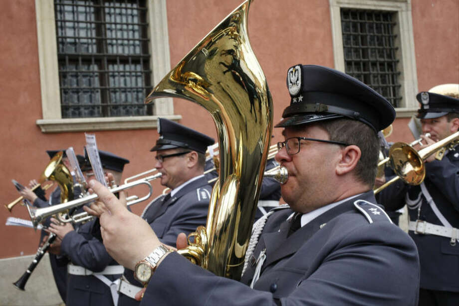 A Polish military band performs as U.S. President Barack Obama participates in the 25th anniversary celebrations of Poland's first free elections led by the Solidarity movement at the Royal Square in Warsaw, Poland, Wednesday, June 4, 2014. (AP Photo/Charles Dharapak)
