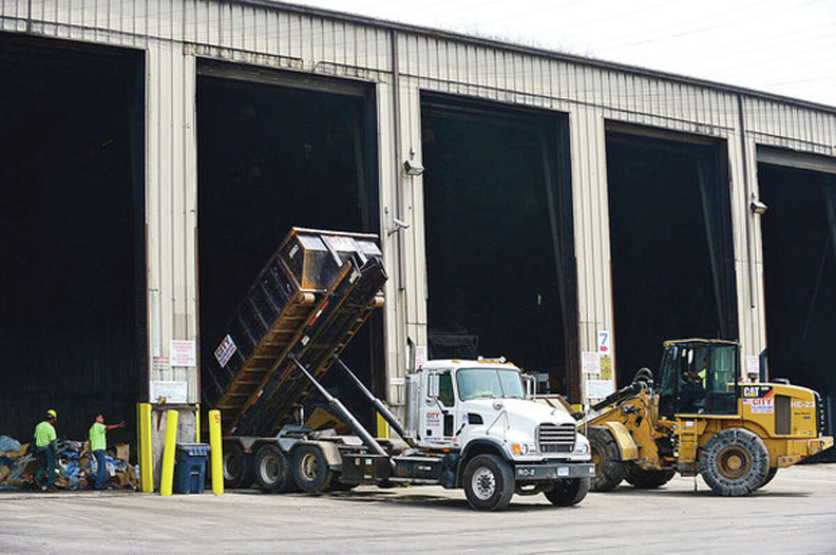 Hour photos / Erik Trautmann City Carting's Meadow Street transfer station is the site of a press conference Wednesday to explain to local residents and officials some of the company's policies to limit the smell emanating from the location.