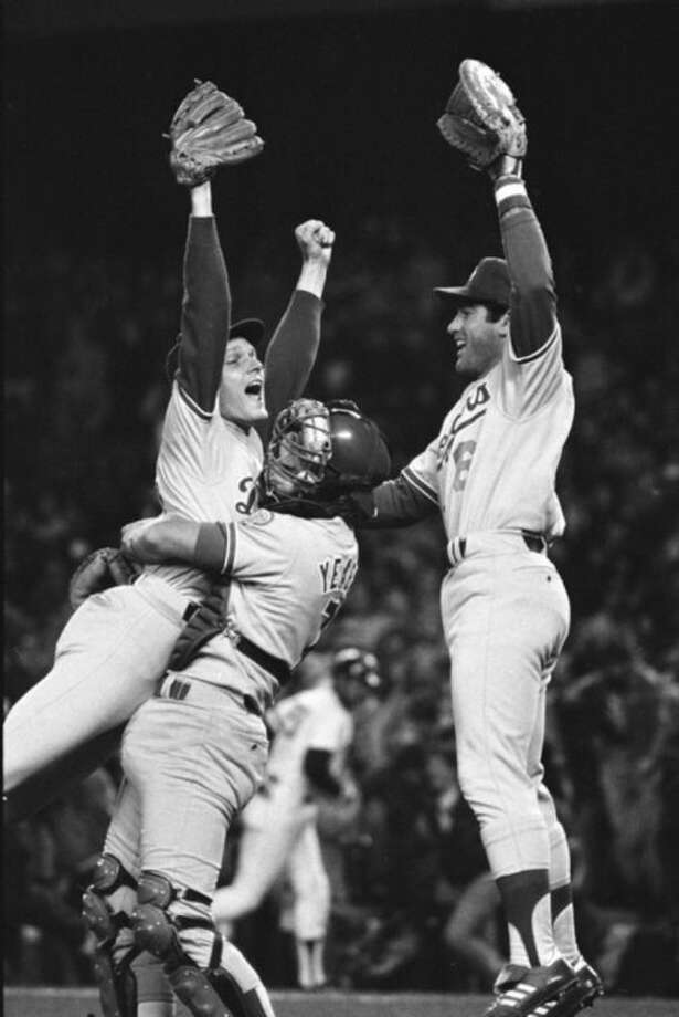 FILE - In this Oct. 28, 1981 file photo, Los Angeles Dodgers relief pitcher Steve Howe, left, first batsman Steve Garvey, right, and catcher Steve Yeager celebrate after the Dodgers defeated the New York Yankees to win the World Series at Yankee Stadium in New York. It's been 33 years since teams from these cities played for a title. The rivalry could be lost on many fans when the Kings and Rangers meet for the Stanley Cup. (AP Photo, File)