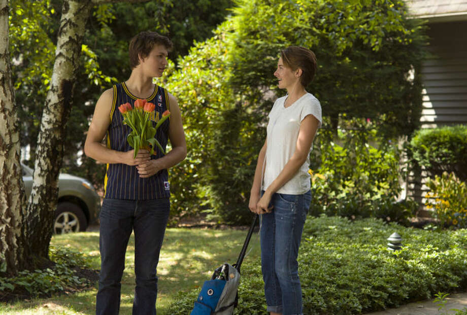 "This image released by 20th Century Fox shows Ansel Elgort, left, and Shailene Woodley appear in a scene from ""The Fault In Our Stars."" (AP Photo/20th Century Fox, James Bridges)"