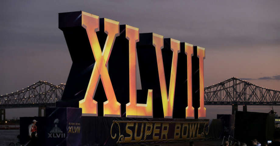 "FILe - In this Feb. 2, 2013 file photo, the Roman numerals for NFL Super Bowl XLVII float on the Mississippi River in New Orleans. The 50th edition of the game will be played in February 2016 in Santa Clara, California. The NFL said Wednesday it will be called ""Super Bowl 50"" instead of ""Super Bowl L."". (AP Photo/Charlie Riedel, File)"