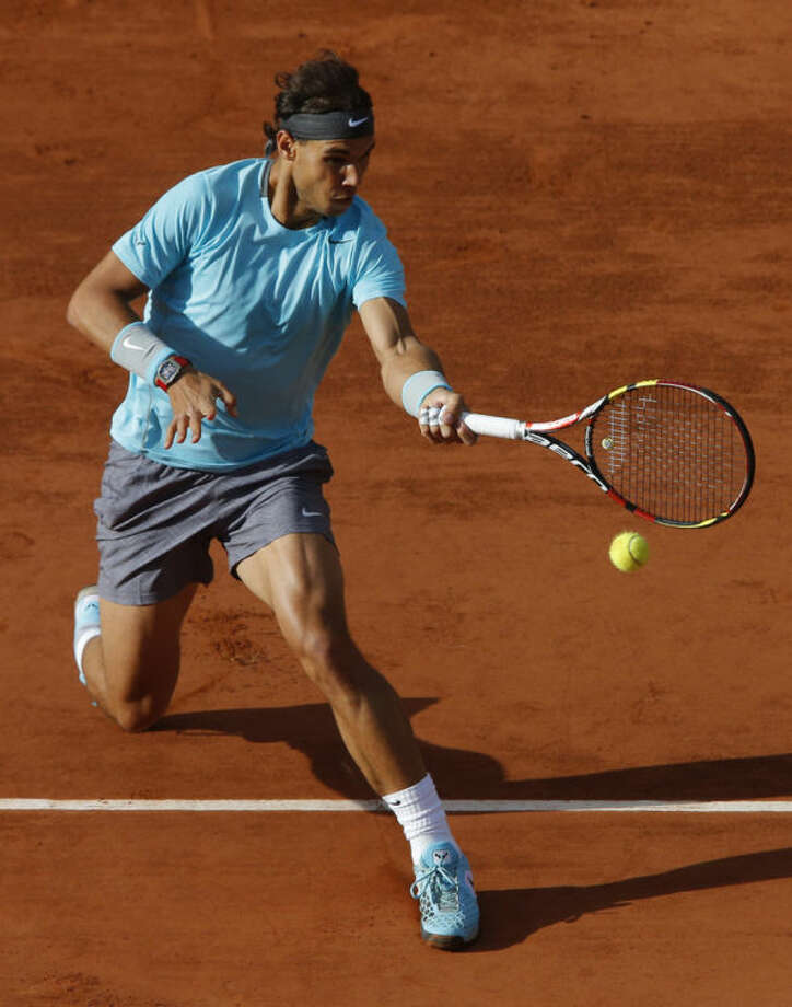 Spain's Rafael Nadal returns the ball during the quarterfinal match of the French Open tennis tournament against Spain's David Ferrer at the Roland Garros stadium, in Paris, France, Wednesday, June 4, 2014. (AP Photo/Michel Spingler)