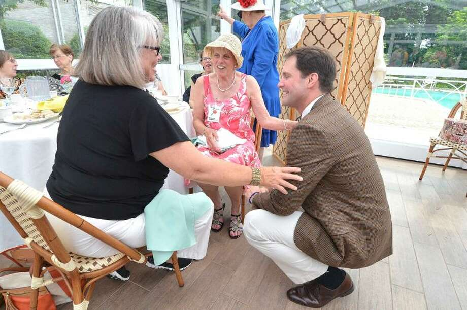 Hour Photo/Alex von Kleydorff Congressman Jim Himes talks with all the members during the Norwalk Garden Club's 90 year anniversary high tea at The Norwalk Inn