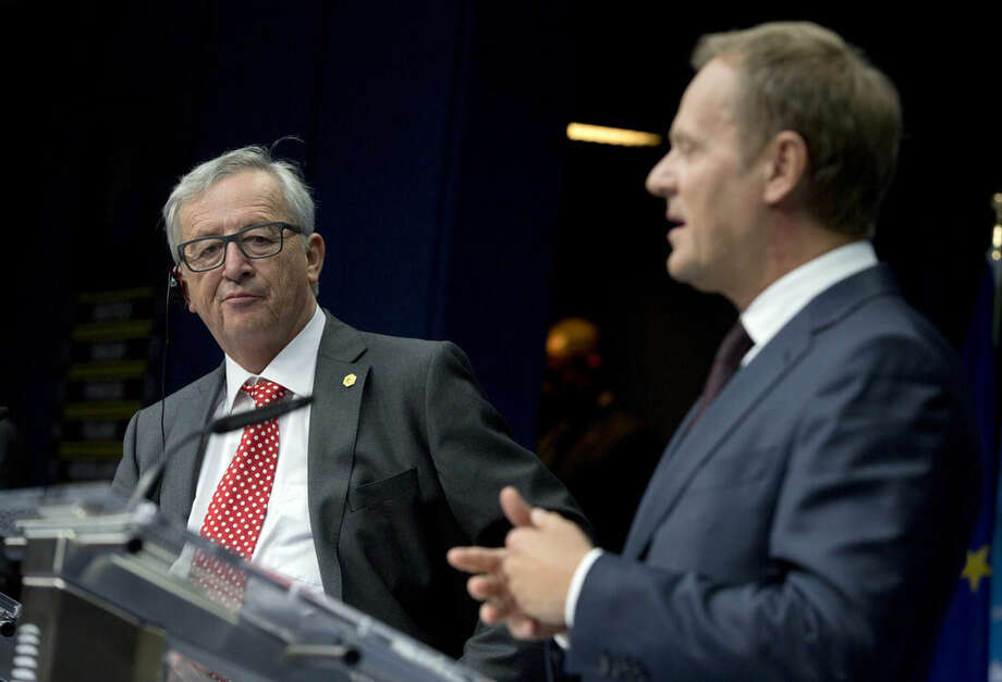 European Commission President Jean-Claude Juncker, left, and European Council President Donald Tusk participate in a media conference after an EU summit in Brussels on Friday, June 26, 2015. European leaders have tasked finance ministers from the euro countries with concluding a debt financing agreement with Greece over the weekend, just days before Athens has to meet a crucial debt deadline. (AP Photo/Virginia Mayo)