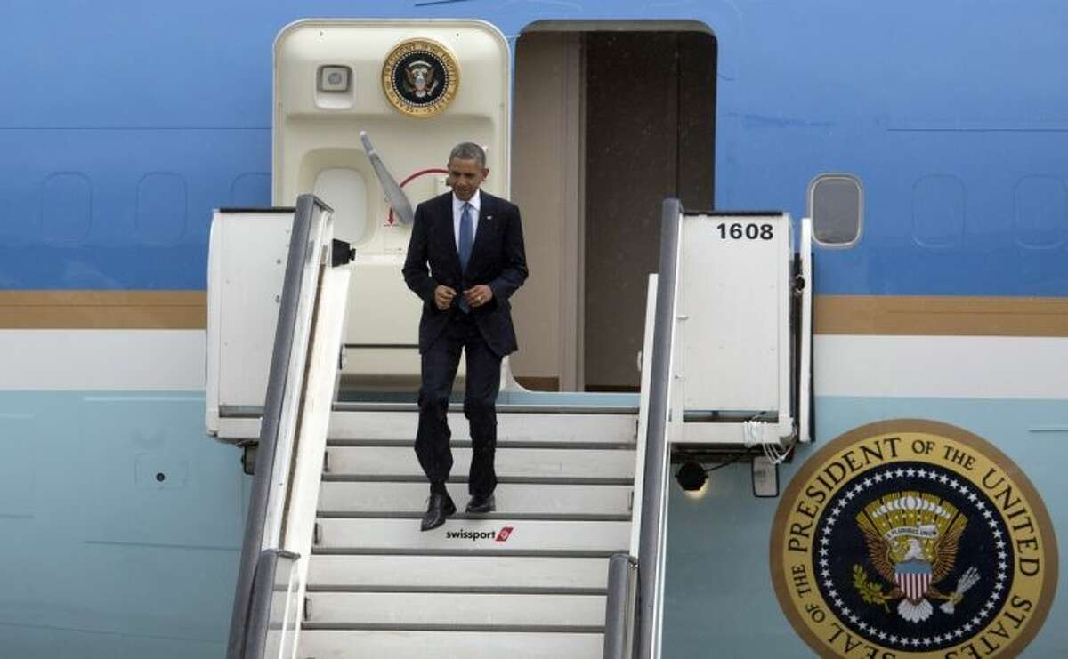 U.S. President Barack Obama arrives at Melsbroek military airport in Melsbroek, Belgium on Wednesday, June 4, 2014. President Obama is in Brussels to attend a two day summit of G7 leaders. (AP Photo/Virginia Mayo)