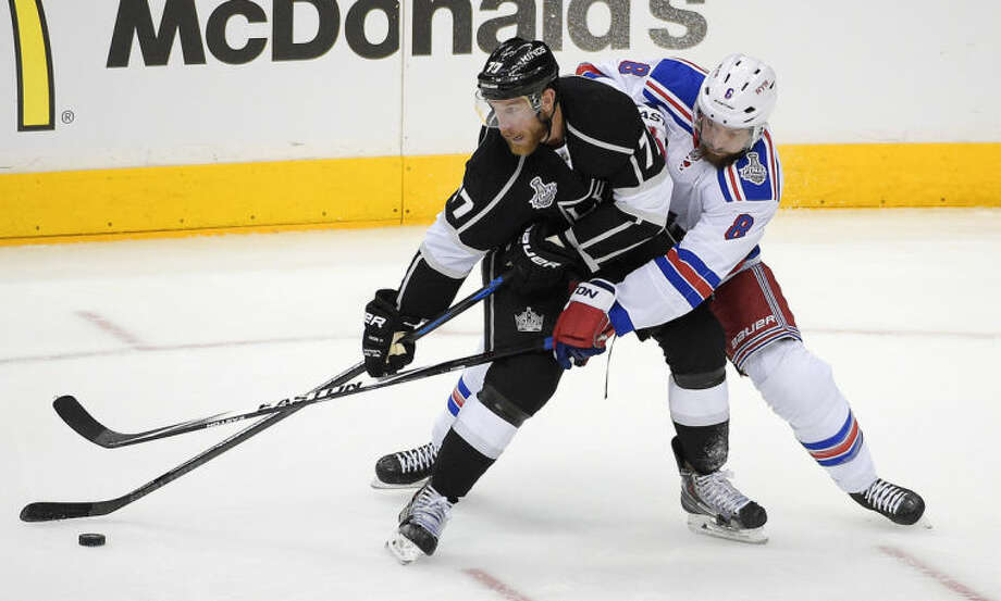 Los Angeles Kings center Jeff Carter battles New York Rangers defenseman Kevin Klein for the puck during the second period in Game 1 of the NHL hockey Stanley Cup Finals, Wednesday, June 4, 2014, in Los Angeles. (AP Photo/Mark J. Terrill)