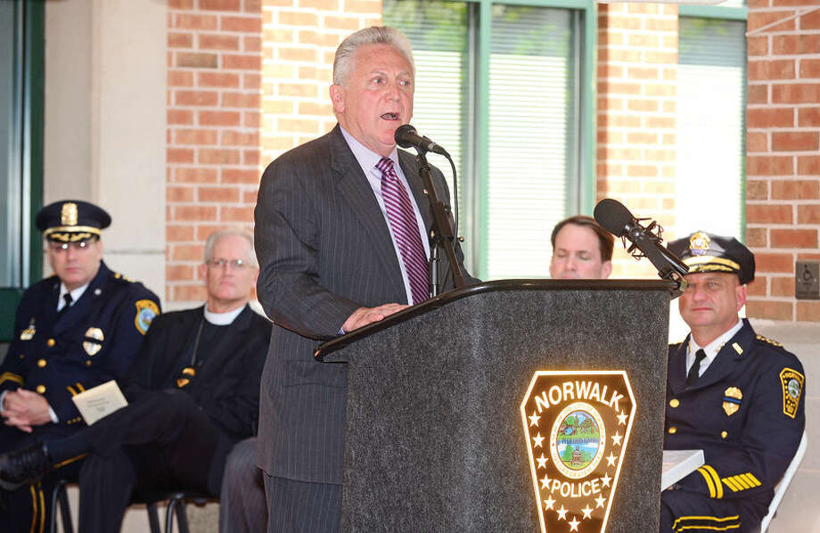 Hour photo / Erik Trautmann Norwalk Harry Rilling makes his remarks during the annual Norwalk Police Department Police Memorial Service Friday at police headquarters.