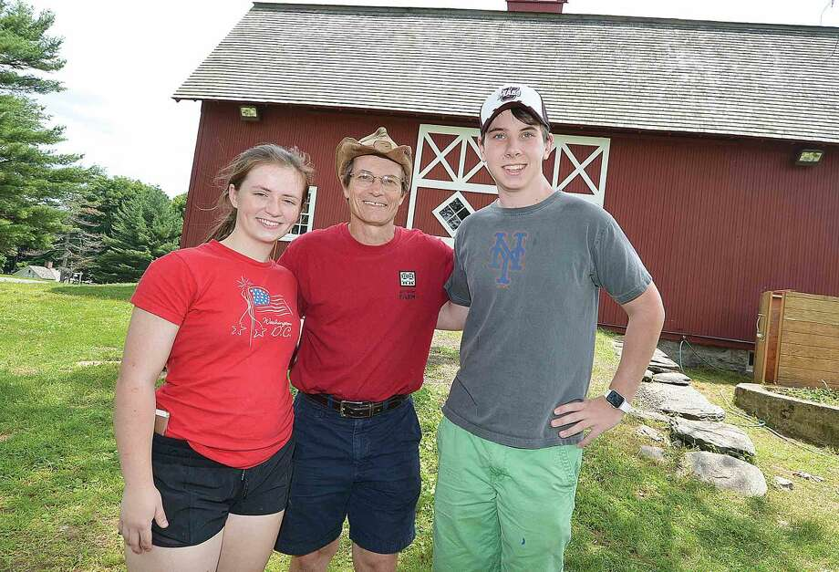 Ambler farm Program Director Kevin Meehan with the 2015 Raymond-Ambler Award-winners Kate Meehan and Sam Schmitt.