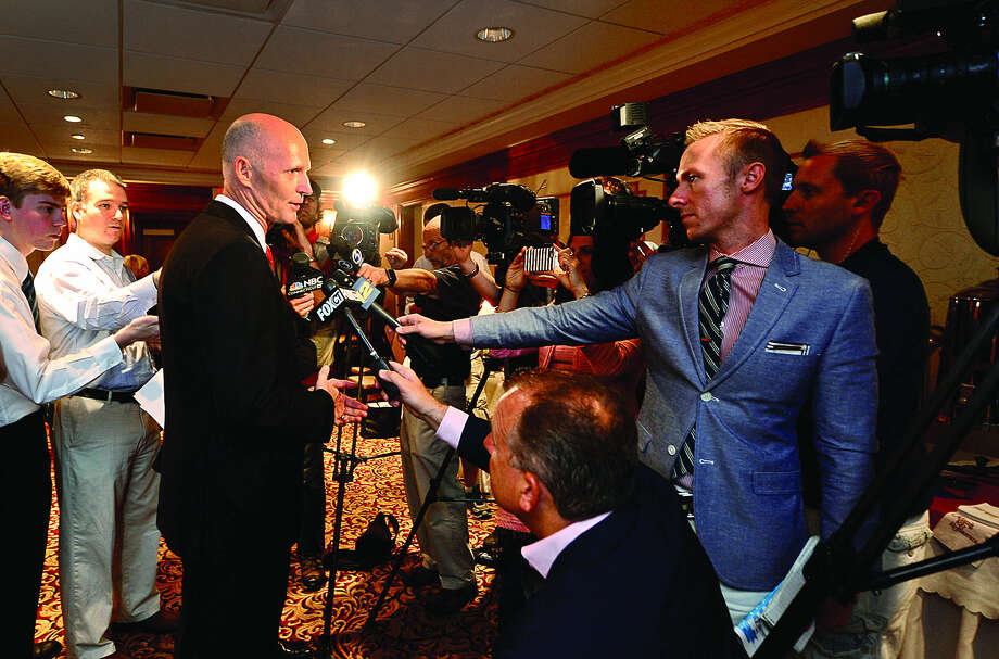 Hour photo / Erik Trautmann Florida Governor Rick Scott speaks with the press after Connecticut business leaders hosted the governor for a jobs roundtable discussion at the Norwalk Inn Friday monring.