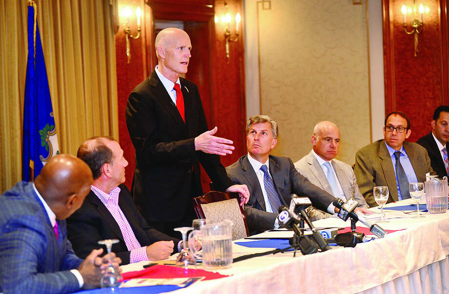 Hour photo / Erik Trautmann Connecticut business leaders host jobs roundtable with keynote speaker Florida Governor Rick Scott at the Norwalk Inn Friday monring.