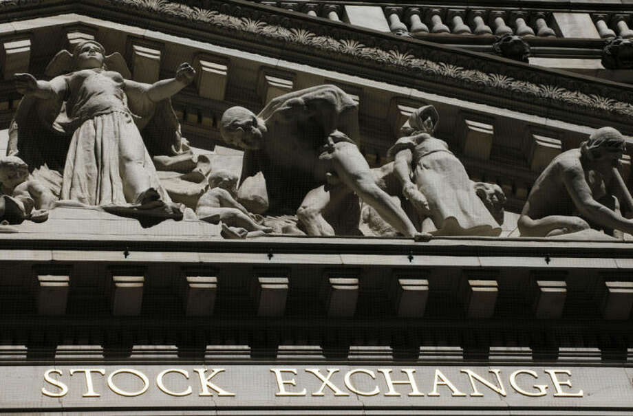 FILE - This July 15, 2013 file photo shows the New York Stock Exchange in New York. Stock futures are climbing on Monday, July 14, 2014, as investors look to shake off the worst week for the stock market in three months. Citigroup's shares rose after it turned in better earnings and revenue than Wall Street expected. (AP Photo/Mark Lennihan, File)