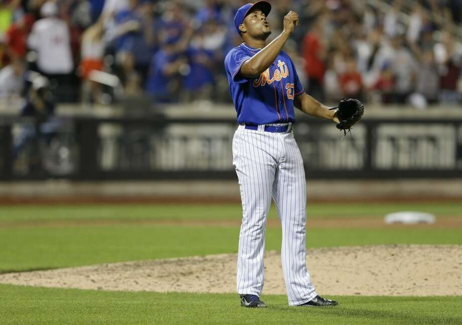 New York Mets relief pitcher Jeurys Familia reacts after the Mets' 2-1 win in a baseball game against the Cincinnati Reds on Friday, June 26, 2015, in New York. (AP Photo/Frank Franklin II)
