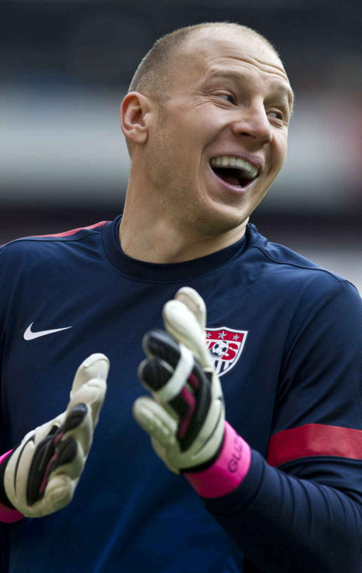 FILe - In this March 25, 2013 file photo, U.S. goalkeeper Brad Guzan smiles during a training session in Mexico City. Guzan, a standout in the English Premier League, would start for a number of World Cup teams. He'll be on the bench for the Americans, waiting for his turn behind veteran keeper Tim Howard. (AP Photo/Christian Palma, File)
