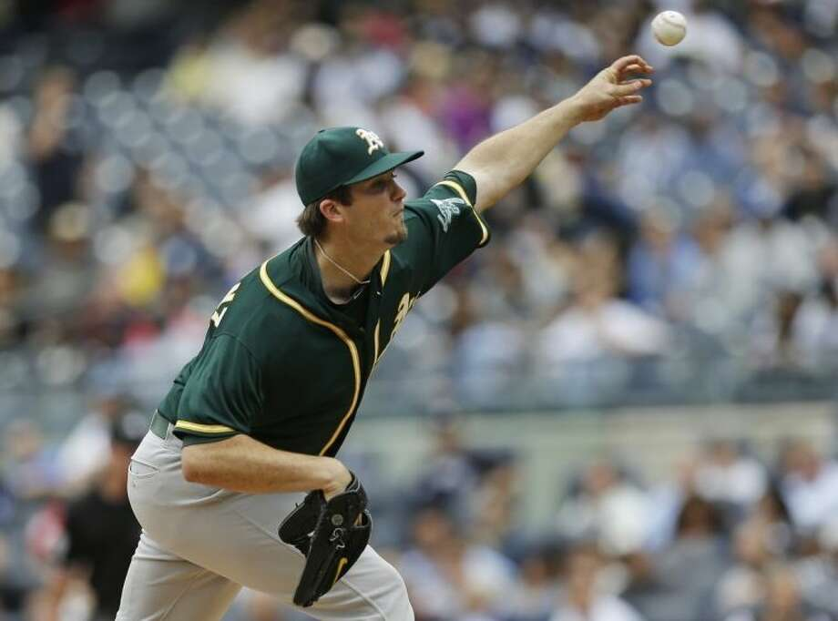 Oakland Athletics' Drew Pomeranz delivers a pitch during the third inning of a baseball game against the New York Yankees Thursday, June 5, 2014, in New York. (AP Photo/Frank Franklin II)