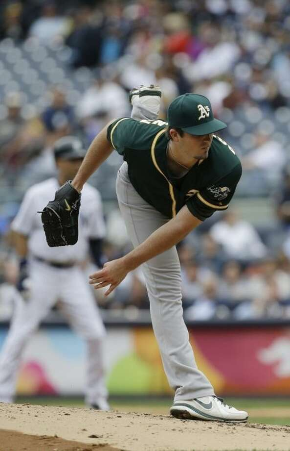 Oakland Athletics' Drew Pomeranz delivers a pitch during the first inning of a baseball game against the New York Yankees Thursday, June 5, 2014, in New York. (AP Photo/Frank Franklin II)