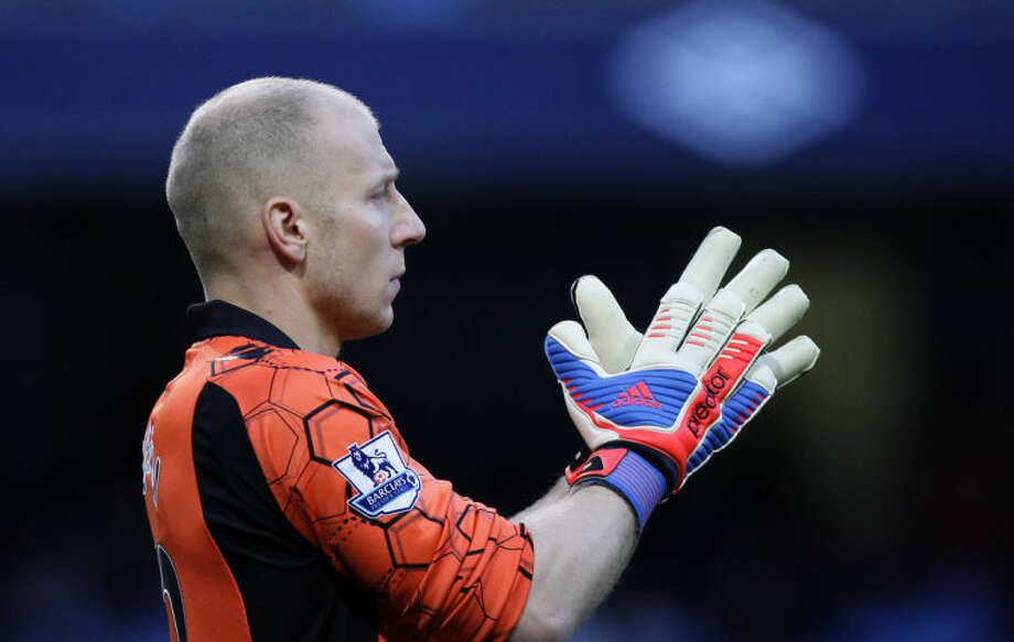 FILE - In this Nov. 17, 2012 file photo, Aston Villa's goalkeeper Brad Guzan looks on during a soccer match against in Manchester, England. Guzan, a standout in the English Premier League, would start for a number of World Cup teams. He'll be on the bench for the Americans, waiting for his turn behind veteran keeper Tim Howard. (AP Photo/Jon Super, File)