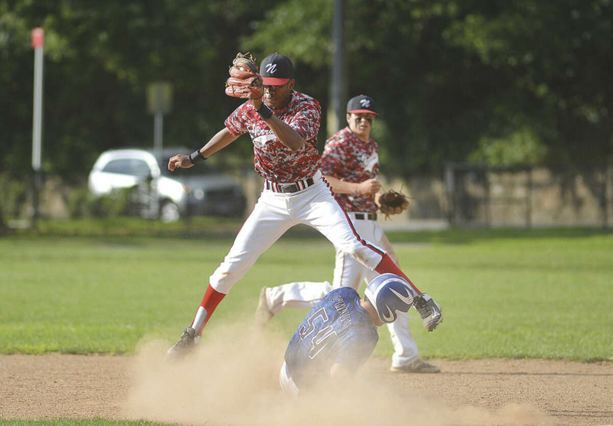 Hour photo/Alex von Kleydorff Norwalk Post 12's Edwin Owolo makes the catch and tries for the out at second base vs Darien-New Canaan on Friday at Malmquist Field.
