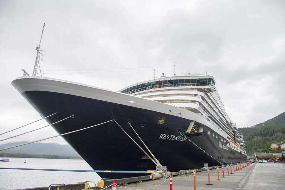 The Holland America Line cruise ship Westerdam sits in dock in Ketchikan, Alaska, on Thursday, June 25, 2015. Officials say eight passengers on an excursion off the ship and a pilot were in a plane that was found crashed against the granite rock face of a cliff about 20 miles northeast of Ketchikan, Alaska. All nine people aboard died in the crash, authorities said. (Taylor Balkom/Ketchikan Daily News via AP).