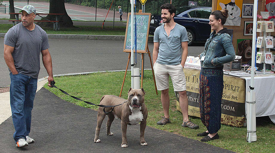 Hour photo/Chris Bosak Flex, a pure breed Pit Bull, was a big hit at the Norwalk Art Festival, which opened Saturday at Mathews Park in Norwalk. The Festival continues Sunday from 10 a.m. to 5 p.m.