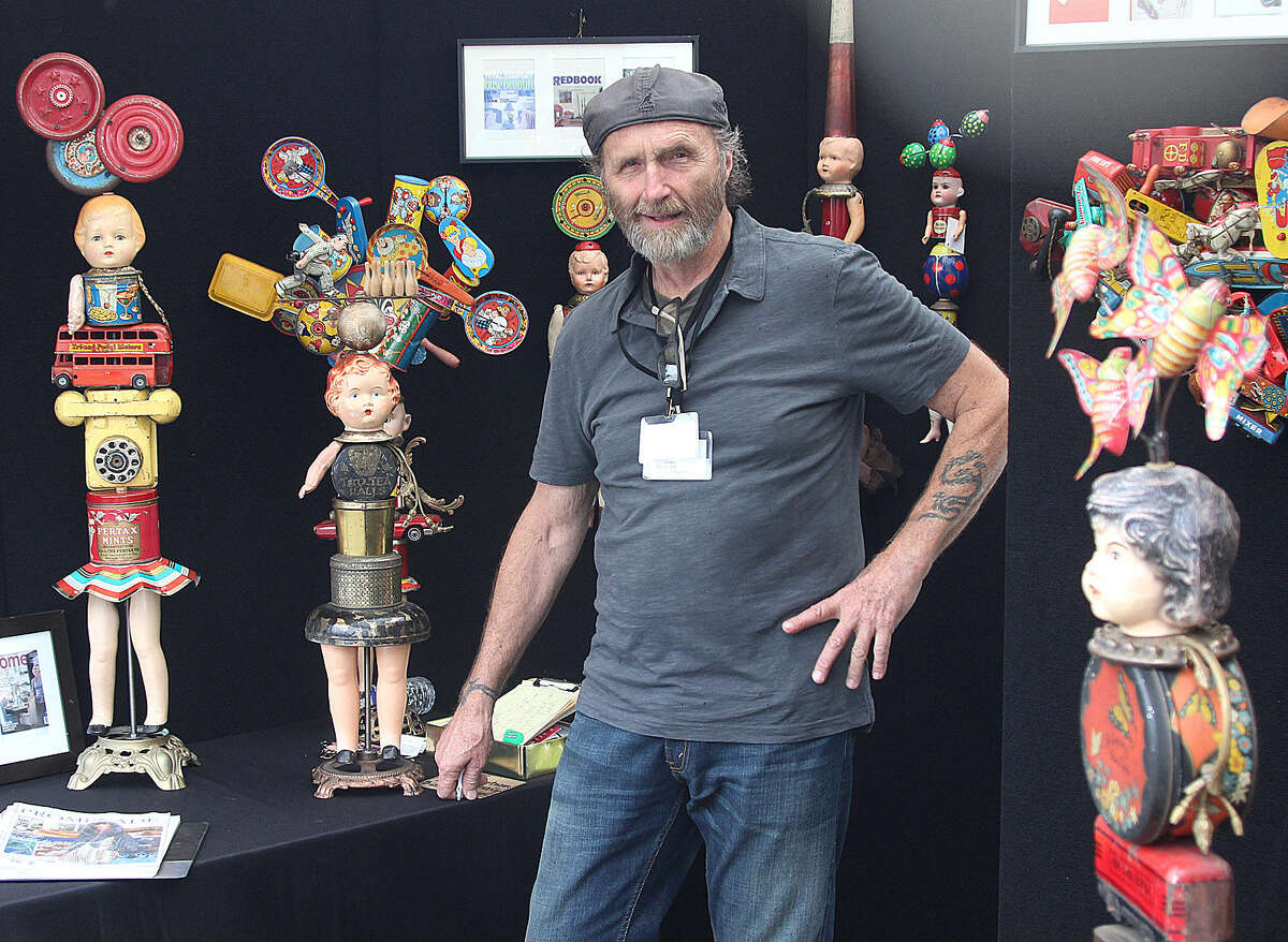 Hour photo/Chris Bosak Bill Finks mans his recycled art booth at the Norwalk Art Festival, which opened Saturday at Mathews Park in Norwalk. The Festival continues Sunday from 10 a.m. to 5 p.m.